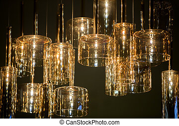 Yellow glass lamps on a dark background.