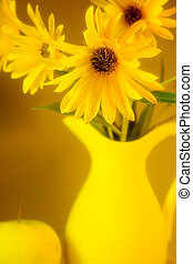 Still life with yellow daisies. Soft focus.