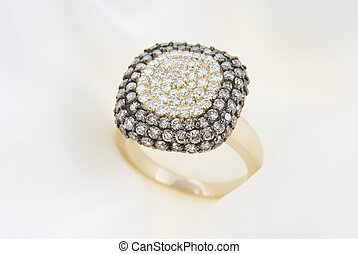 Yellow Gold Ring With Diamonds On Soft White Background