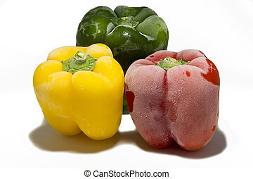 Yellow, green and red peppers isolated on white background