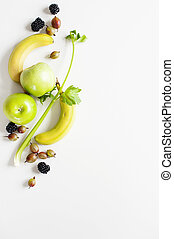 Yellow green fruit on a white background with empty space for text