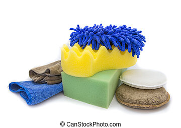Yellow, green sponges and blue mitts for washing and microfiber fabric with cleaner cloth on white background