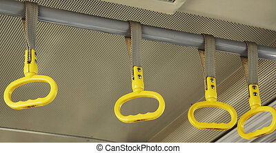 handhold - Yellow handholds in the airport bus