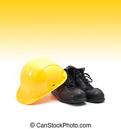 Yellow hard hat and old boots