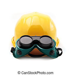 Yellow hard hat and protective goggles