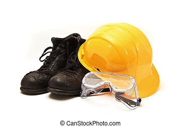 Yellow hard hat, old leather boots and protective goggles