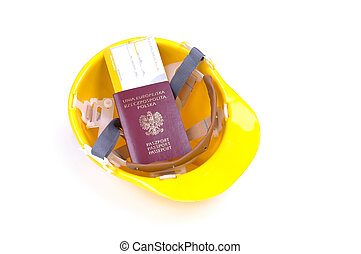 yellow hard hat with passport and boarding pass