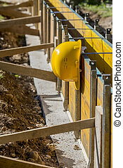 Yellow hardhat on a building site