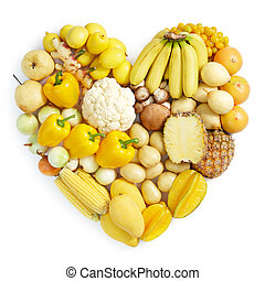 yellow healthy food - heart shape form by various vegetables...
