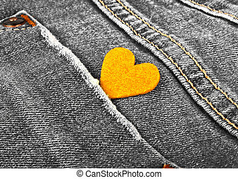 Yellow heart in jeans pocket