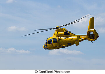 Yellow Helicopter flying