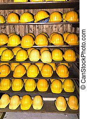 yellow helmets for visitors at the gem mine