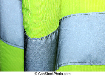 Close up of a yellow hi visibility jacket.