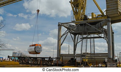 Yellow Hoisting Crane Keeps Cistern. Heave Industry