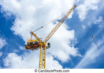 yellow hoisting crane with wonderful blue sky