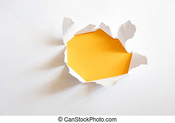 yellow hole in paper