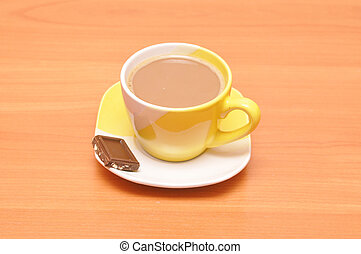 yellow hot coffee cup with chocolate