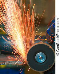 sparks - Yellow hot sparks at grinding steel material
