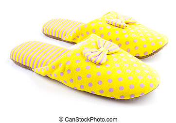 Yellow house slippers isolated on white background