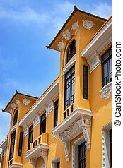 yellow house with balcony