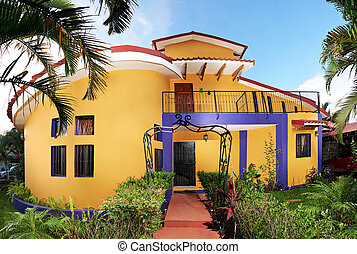 Yellow house with interesting design