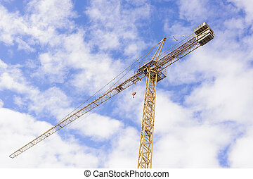 Yellow Industrial Crane   Against Blue Sky