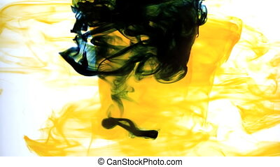 Yellow ink swirling into water whirlpool in slow motion
