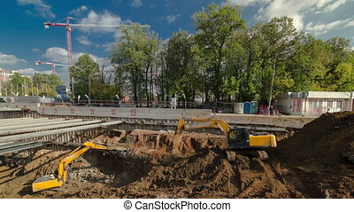 Yellow jackhammer machine on a construction site timelapse -...
