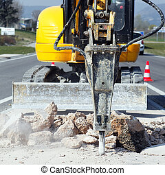 yellow jackhammer on building site in summer