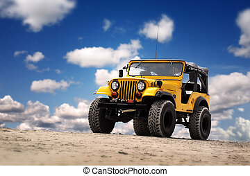 Yellow Jeep at the beach