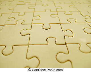 Yellow jigsaw - Yellow puzzle close-up