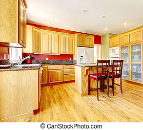 Yellow kitchen with island and yellow wood.