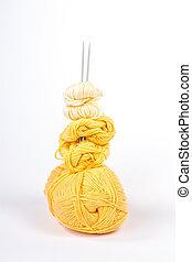 Yellow knitting needles pyramid