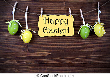 Yellow Label With Four Easter Eggs And Happy Easter