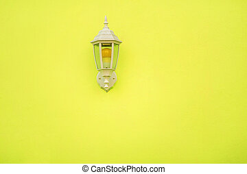 Yellow lamp on a yellow wall.
