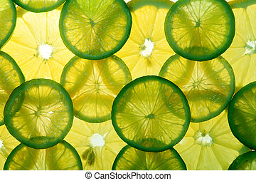 Yellow lemon and green lime slices in many layers