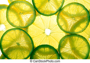 Yellow lemon and green lime slices in two layers