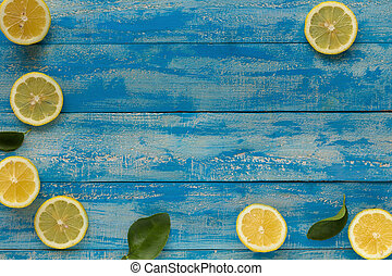 Yellow lemon on a blue wooden background. Top view