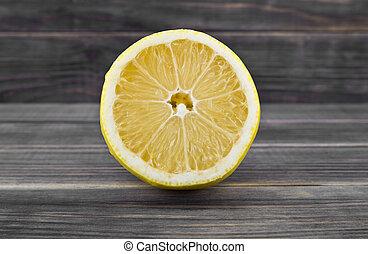 yellow lemon on wooden background