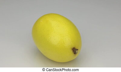Yellow lemon rotates on its axis.