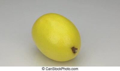 Yellow lemon rotates on its axis.