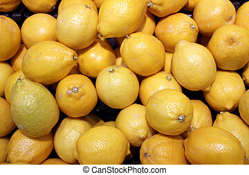 Yellow lemons fruits are sold in the market