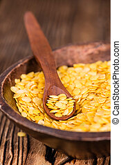 Yellow Lentils (detailed close-up shot) on wooden background