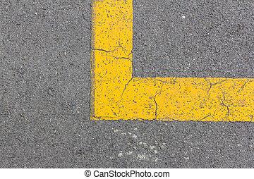 Yellow line corner on asphalt road
