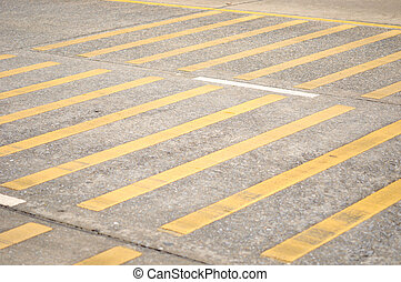 yellow line sign on the road for reduce speed, must be careful, attention for law.