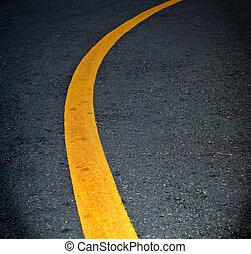 Yellow lines on asphalt