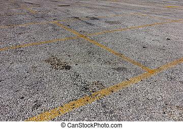 yellow lines on dirty bright asphalt