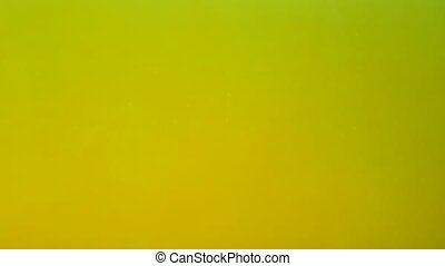 Yellow liquid with bubbles. Abstract background.