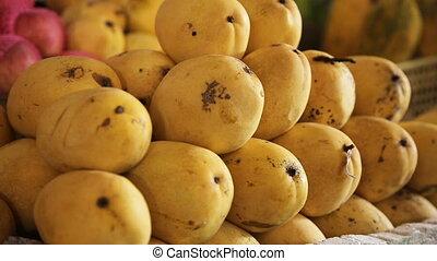yellow mango on fruit market - Selling yellow mango on fruit...