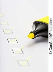 Yellow marker with markers on the checklist sheet.